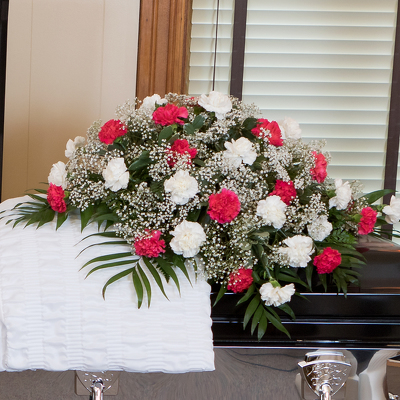 Carnation Classic Casket Spray from Casey's Garden Shop & Florist, Bloomington Flower Shop
